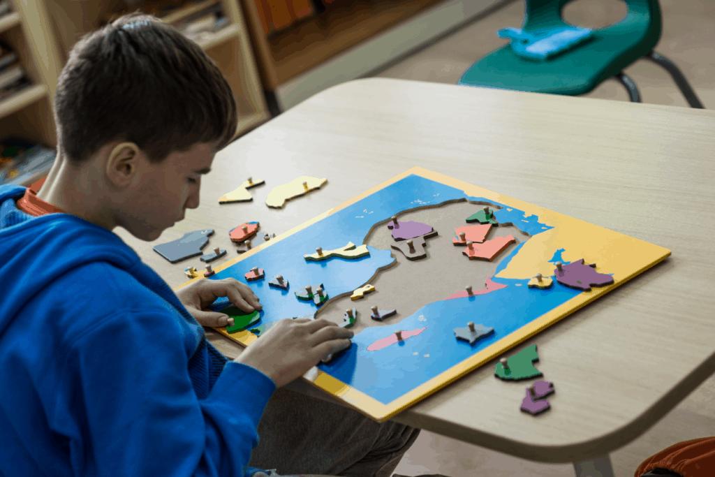 boy in montessori classroom