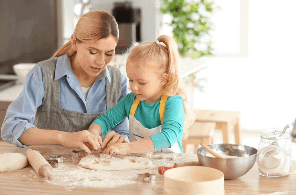 kid and mom baking