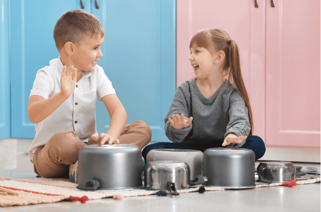 kids playing music with pots and pans
