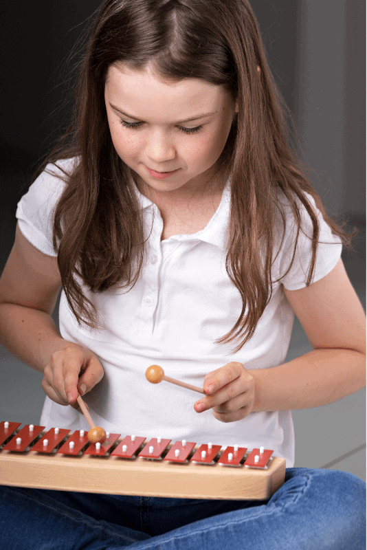 child with xylophone